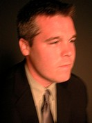 Out of focus headshot of man in necktie