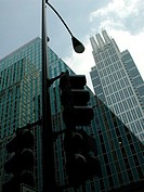 Angled shot of traffic light and top portion of buildings in Chicago