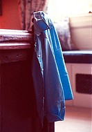 Blue shirt hanging from bedpost
