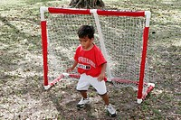 Family Festival of the Arts, disabled activities, Hispanic boy guards soccer goal net. Kendall. Miami. Florida. USA.