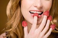 Woman eating raspberries