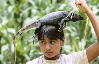 Girl with iguana. Yucatan Province. Mexico