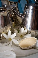 Spa elements, Silver teapots with soap and gardenias on white cloth