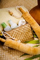 Spa elements, Bath products in a lauhala purse with towel and natural loofah