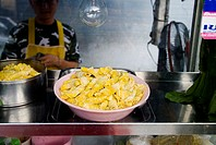 Thailand, Bangkok, unusual delicacies found at street vendor food stalls, bowl of rolled pastries