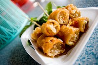 Thailand, Bangkok, Appetizing plate of Thai spring rolls from one of the many street vendors
