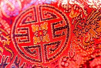 Close-up of bright red cloth with Chinese embroidery