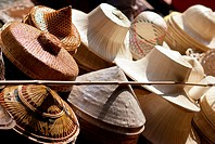 Thailand, Bangkok, Damnoen Saduak Floating Market in Ratchaburi Province, traditional straw hats for sale