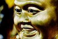 Thailand, Bangkok, Close-up of a shiny bronze Buddha