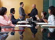 Businessmen Shaking Hands at Meeting