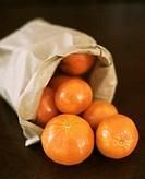 Oranges in Paper Bag