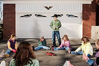 Children Playing With Radio Controlled Car on Driveway