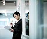 Businesswoman in Office Corridor