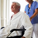 Nurse Pushing Patient in Wheelchair (thumbnail)