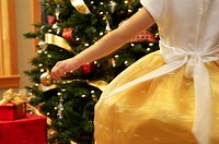 Girl dancing in front of a Christmas tree