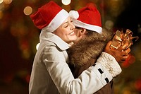 Man and woman hugging at Christmas