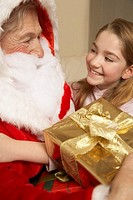 Young girl with Santa Claus