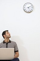 Businessman watching the clock