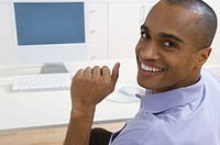 Smiling businessman at his desk