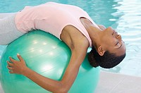 Woman stretching on a fitness ball (thumbnail)