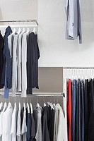 Shirts and pants hanging on a clothing rack