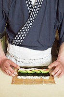 Chef making sushi roll