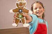 Young girl with gingerbread cookie