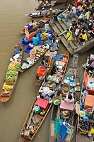 Floating Market southwest of Bangkok. Amphawa Floating Market. Vegetable vendors meet on canal in the afternoon every friday suterday and sunday