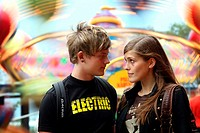 A young couple in love at the Linnanmäki amusement park