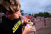 A boy counts his money at the Linnanmäki Amusement Park