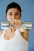 Portrait of a mid adult woman holding a dumbbell