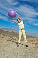 Woman with balance ball