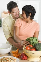 Hispanic couple preparing food
