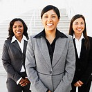 Ethnic-ethnic businesswomen next to outdoors stairs