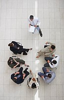 Aerial view of businessman presenting to group of businesspeople