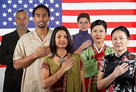 Ethnic-ethnic people standing in front of American flag