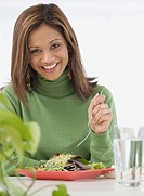 Indian woman eating salad