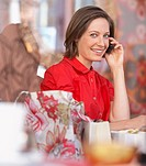 Woman talking on cell phone (thumbnail)
