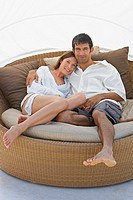 Man and woman snuggling on chair