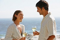 Man and woman outdoors with wine