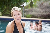 Portrait of woman in front of swimming pool