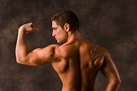 Muscular man, flexing left bicep
