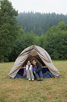 Portrait of Indian couple sitting in tent