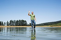 Man walking on water waving