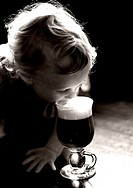 baby tasting Irish coffee