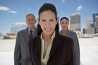Businesswoman with co-workers in urban background
