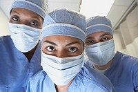 Close up of doctors wearing surgical masks