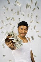 Portrait of Asian man holding wad on money