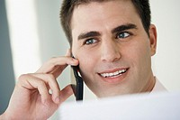 Middle Eastern businessman talking on cell phone