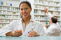 Hispanic female pharmacist in pharmacy